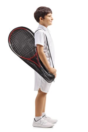 Full length profile shot of a child carrying a tennis racket in a case isolated on white background Imagens