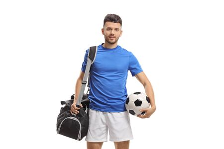 Soccer player with a sports bag and a football isolated on white background
