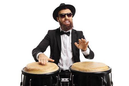 Portrait of a man in a suit playing conga drums isolated on white background Stock fotó