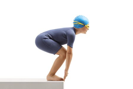 Little boy swimmer in a wetsuit on the start line isolated on white background