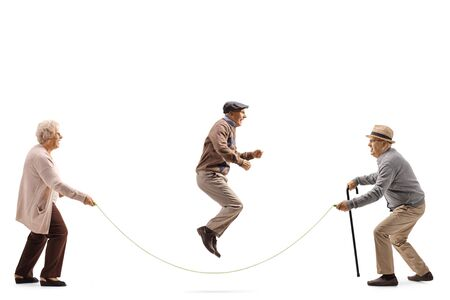 Full length profile shot of senior people skipping a rope isolated on white background Reklamní fotografie
