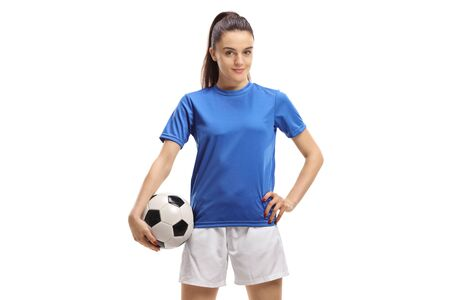 Female soccer player posing with a football isolated on white background