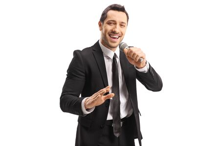 Young handsome man with a microphone in his hand isolated on white background