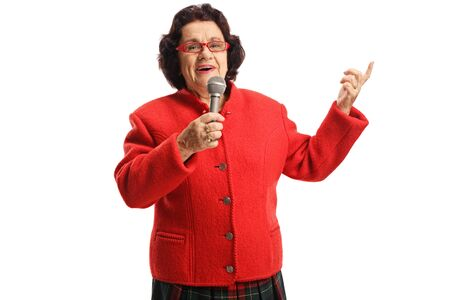 Senior woman holding a microphone and singing isolated on white background
