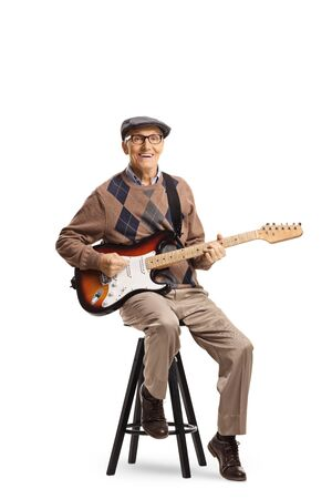 Full length portrait of a senior man sitting on a chair with an electric guitar isolated on white background