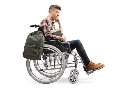 Unhappy male disabled student in a wheelchair isolated on white background