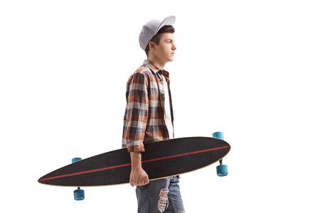 Male teenager with a longboard standing isolated on white background