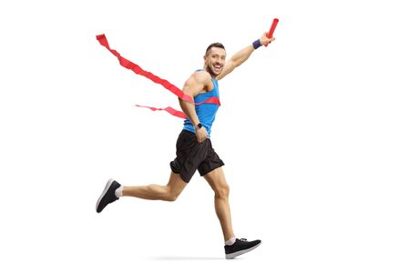 Full length shot of a man on the finish line of a marathon race with a baton in his hand isolated on white background
