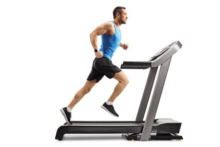 Full length shot of a young man in sportswear running on a professional treadmill isolated on white background