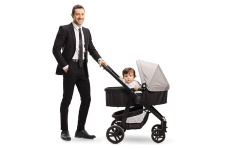 Full length shot of a working dad in a suit with a baby in a stroller isolated on white background