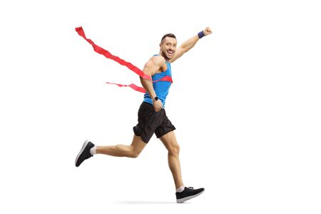 Full length shot of a young athlete man on the finish line of a marathon race isolated on white background 写真素材