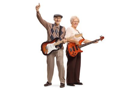 Full length portrait of cool elderly man and woman with electric guitars isolated on white background