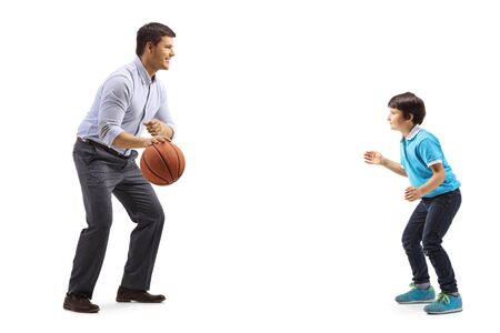 Full length shot of a casual man and a child playing basketball isolated on white background