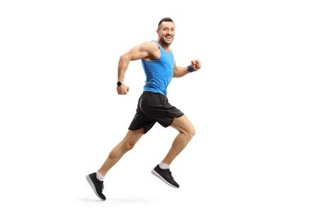 Full length shot of a young male in sportswear running and looking at the camera isolated on white background