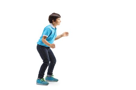 Full length shot of a boy gesturing as waiting for something isolated on white background 写真素材