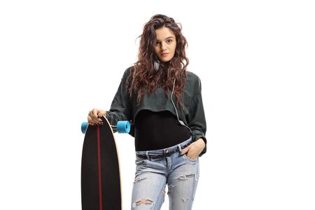 Girl standing and holding a longboard isolated on white background
