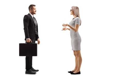 Full length profile shot of a young woman and businessman having a conversation isolated on white background 写真素材