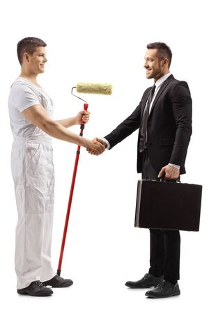 Full length profile shot of a painter shaking hands with a businessman isolated on white background