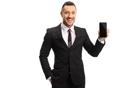 Biusinessman holding a mobile phone isolated on white background