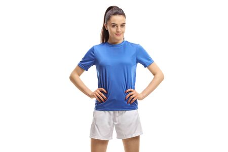 Young female soccer player posing isolated on white background