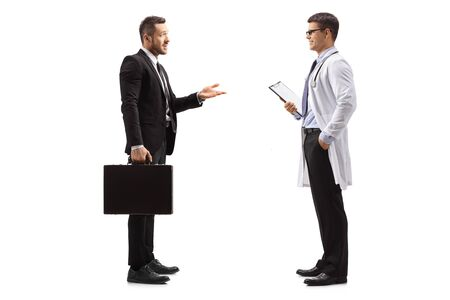 Full length profile shot of a pharmaceutical company representative talking to a doctor isolated on white background