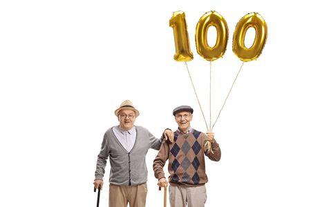 Two senior men with a golden number hundred balloon isolated on white background
