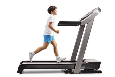 Full length profile shot of a boy running on a treadmill isolated on white background