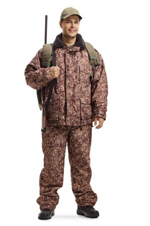 Full length portrait of a hunter in a camouflage uniform isolated on white background