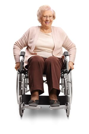 Elderly disabled female in a wheelchair isolated on white background
