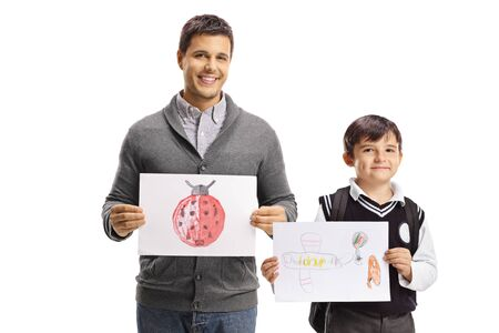 Father and schoolboy holding drawings and smiling isolated on white