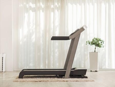 Shot of a professional modern treadmill at home