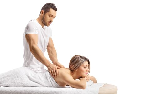 Master masseur giving a professional massage to a woman isolated on white 스톡 콘텐츠