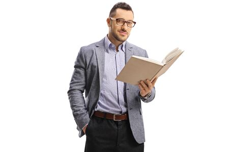 Young elegant man standing and holding an open book isolated on white