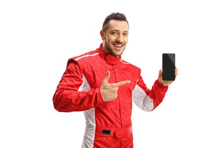 Formula racer holding a mobile phone and smiling isolated on white