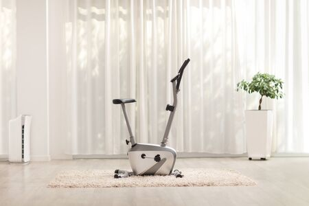 Shot of a stationary exercise bike at a luxury home 版權商用圖片