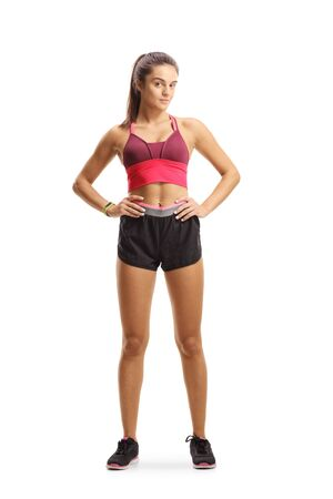 Full length portrait of a young female in sportswear posing isolated on white background Banco de Imagens