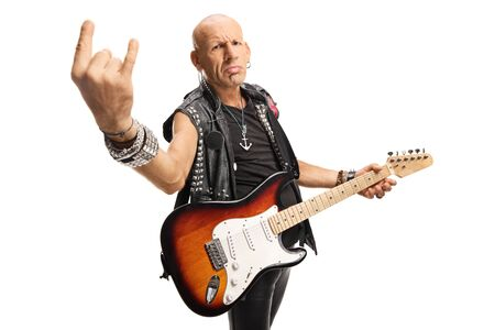 Male rock star with a guitar gesturing rock and roll sign isolated on white background