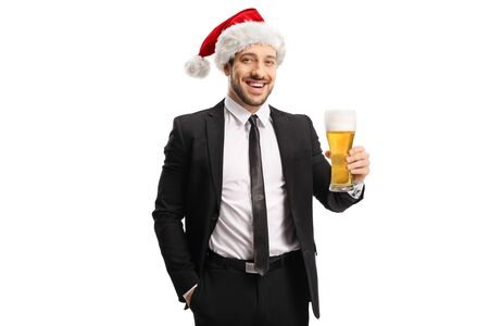 Businessman wearing a Santa Christmas hat and holding a glass of beer isolated on white background