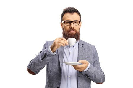 Bearded guy with glasses drinking espresso coffee isolated on white background