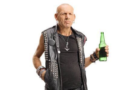 Grumpy punk man holding a bottle of beer isolated on white Stok Fotoğraf
