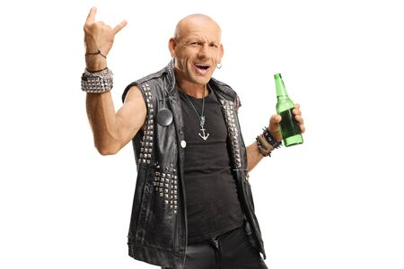 Bald punk with a bottle of beer gesturing horn sign isolated on white