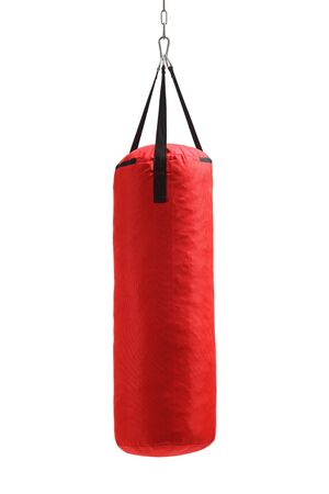 Studio shot of a red punching bag hanging isolated on white