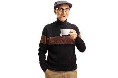 Elderly man posing with a cup of tea isolated on white