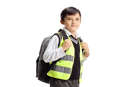Little boy with backpack and safety vest isolated on white background