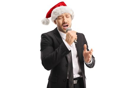 Man with a christmas hat singing on a microphone isolated on white