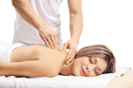 Woman enjoying a back massage with closed eyes isolated on white 写真素材