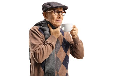 Senior man suffering from sore throat and having a hot tea isolated on white Stock Photo