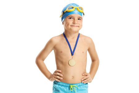 Child swimmer with a gold medal isolated on white