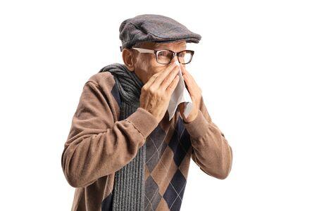 Senior man sneezing and wiping nose isolated on white background
