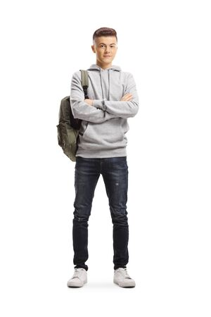 Full length portrait of a male student standing and smiling at the camera isolated on white background Standard-Bild